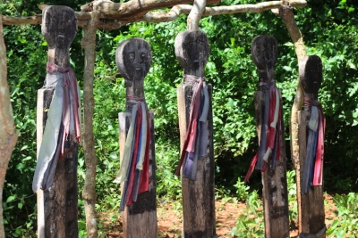 The carved ancestors of the Kauma Clan stand guard inside Kaya Kauma.